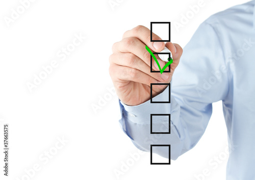 Human hand checking the checklist boxes