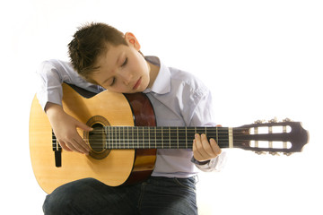 boy with an acoustic guitar isolated on white