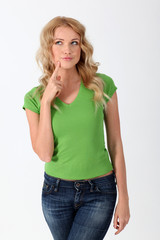 Blond woman with green shirt having thoughtful look