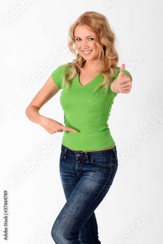 Blond woman in green shirt showing thumb up