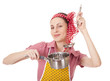 Playful housewife with ladle and pan