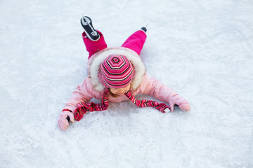 little girl fell to the ice skating