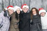 group of happy young people in winter