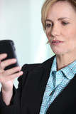 Female executive with mobile phone
