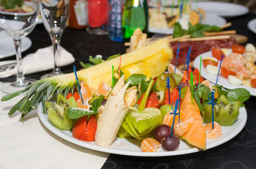 a lot of fruit on plate