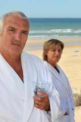 couple of mature people at the beach