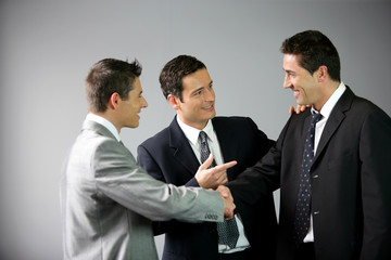 Three businessmen laughing