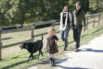 Family with dog in the countryside