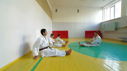 Martial arts instructor training  students
