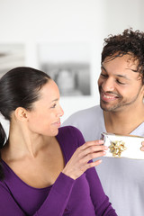 a man giving a present to his wife