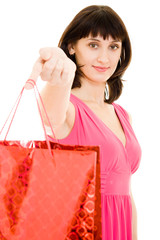 Girl with shopping in the red dress on white background.