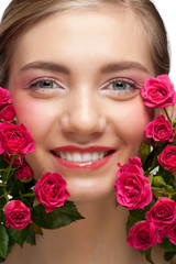 Smiling woman with roses