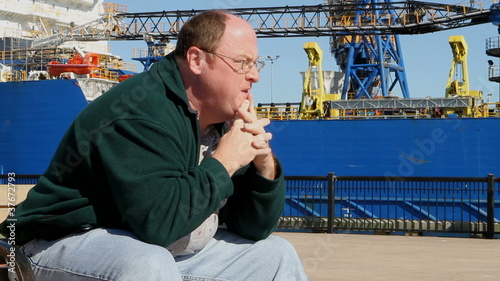 Depressed Man At Shipyard