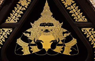Vintage traditional Thai style art painting on temple's door