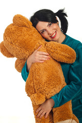 Happy woman huggy teddy bear