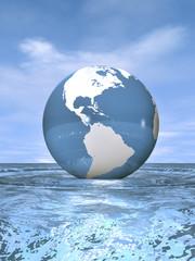 Globus schwimmt auf bewegter Wasseroberfläche unter blauem Himme