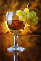 Glass of white wine with grape