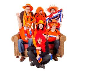 Group of Dutch soccer fan watching game