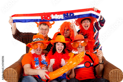 Group of Dutch soccer fan watching game