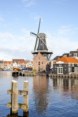 Classic windmill at canal in The Netherlands