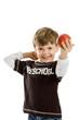 Preschool boy with apple