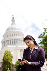 Asian business woman with smartphone on Capitol Hill