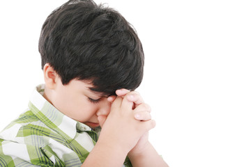 A boys prays earnestly to his creator in heaven