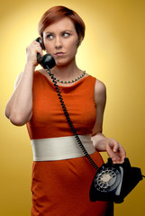 Woman in retro fashion answering the phone