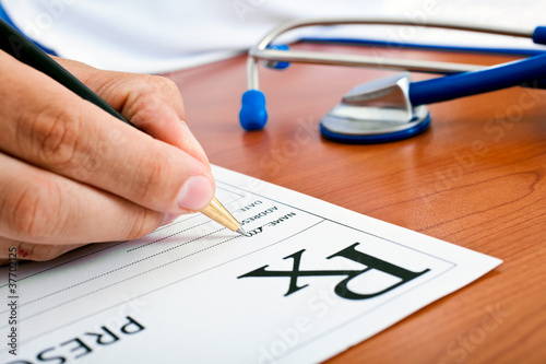 Doctor writing a rx prescription