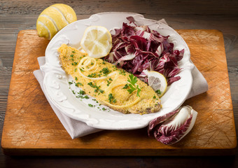 breaded sole with chicory salad and lemon