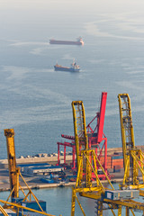 Cranes and cargo ships at the Port of Barcelona