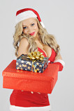 cute smiling young blonde holding Christmas gifts