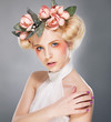 Luxurious supermodel lovely blonde in crown of flowers