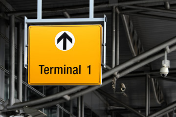 detail view of terminal sign on airport hall