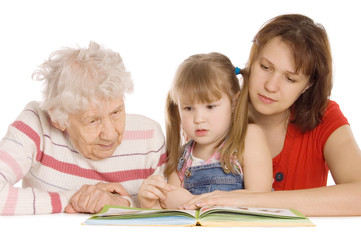Grandmother with the grand daughter read the book