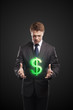 Young  businessman chooses a green US dollar sign