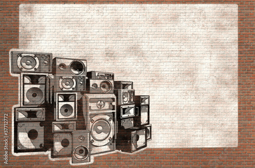 speakers graffiti on brick wall