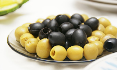 Olives are accurately laid on a plate