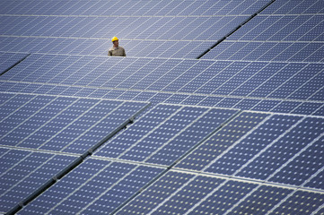 Technician at solar power station