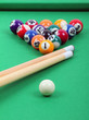 balls and sticks on green billiards table,  lighting from above