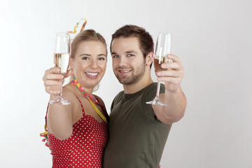 A young couple celebrating