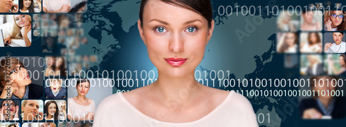 A young pretty woman against world map on background with many d