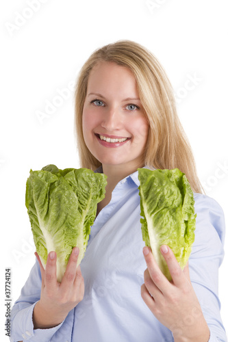 Smiling Blonde Woman Presenting Two Salad Lettuces