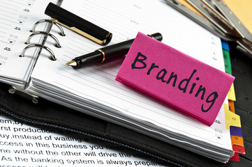 Branding note on agenda and pen
