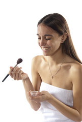 Woman putting on make-up cosmetic's laughing
