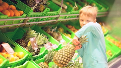 Little boy with pineapple