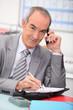 Older businessman using a cellphone
