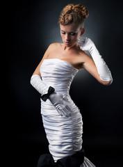 Pretty fiancee blond woman in fashion wedding dress