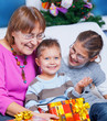 Grandmother and her two grandchildren with gifts
