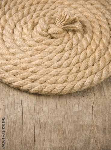 ship ropes and knot on wood